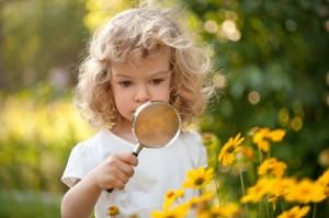Child explorer flowers in garden